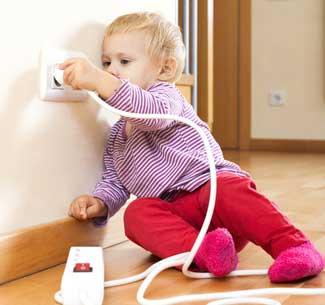 Child playing with Safety Switch Protected Power Point